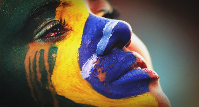 A Brazil fan cries as she watches the 2014 World Cup semi-final between Brazil and Germany at a fan area in Brasilia