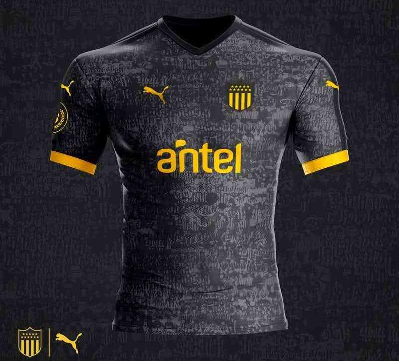 https___wp-images.onefootball.com_wp-content_uploads_sites_13_2019_02_Camisa-Campeon-del-Siglo-do-Penarol-2018-PUMA